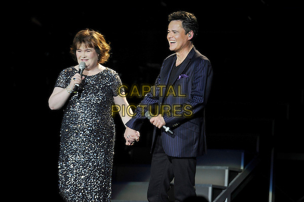 Susan Boyle and Donny Osmond.Live at the O2 Arena, London, England..January 20th 2013.on stage in concert live gig performance performing music half length black dress sparkly subo singing suit holding hands silver  .CAP/MAR.© Martin Harris/Capital Pictures.