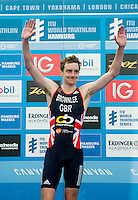 12 JUL 2014 - HAMBURG, GER - Alistair Brownlee (GBR) from Great Britain celebrates winning the men's 2014 ITU World Triathlon Series round in the Altstadt Quarter, Hamburg, Germany (PHOTO COPYRIGHT © 2014 NIGEL FARROW, ALL RIGHTS RESERVED)