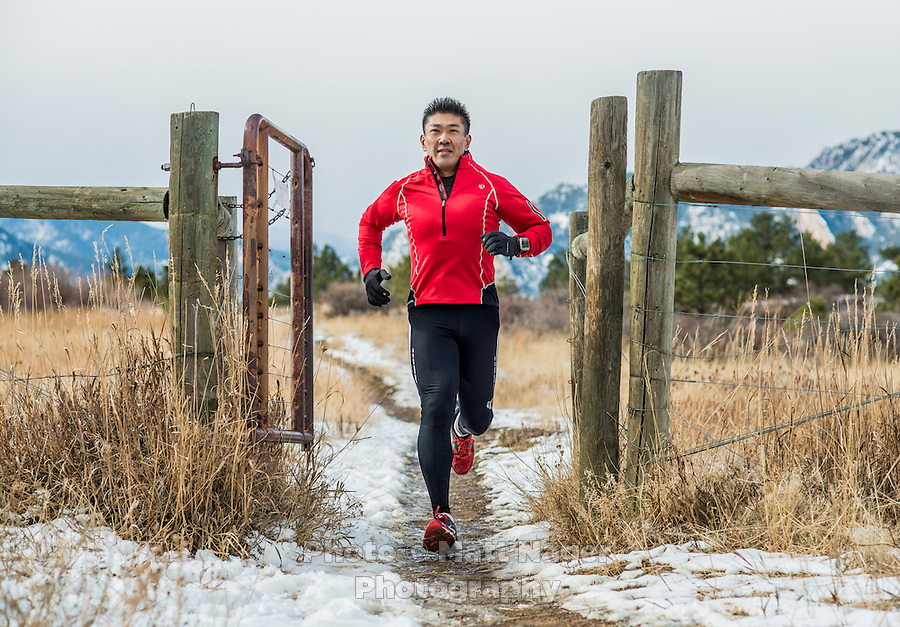 Yusuke Kirimoto runs along the Marshall Mesa Trail in Boulder, Colorado, Saturday, December 10, 2016. Inspired by his daughter, Yusuke has lost over 100lbs through running. <br /> <br /> Photo by Matt Nager