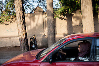 An Afghan woman drives in main street of city_Women are threatened by Taliban from driving /Felix Features