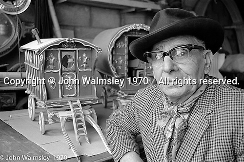 Sylvester Gordon Boswell, Romany leader, with a scale model of a vardo (caravan).  Boston, Lincolnshire, UK.  1970