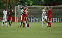 United States and Germany' players congratulate and console each other at the end of the FIFA Under 20 World Cup Group C Match between the United States and Germany at the Mubarak Stadium on September 26, 2009 in Suez, Egypt. The US team lost to Germany 3-0.
