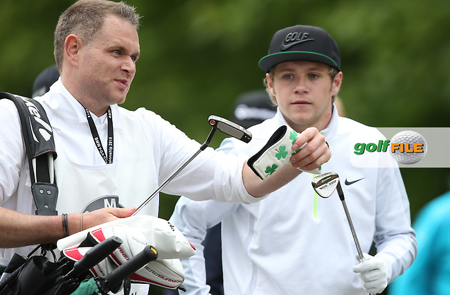 Irish One Direction star Niall Horan heads to the 16th during the Pro-Am ahead of the 2015 BMW PGA Championship over the West Course at Wentworth, Virginia Water, London. Picture David lloyd, www.golffile.ie: 20/05/2015