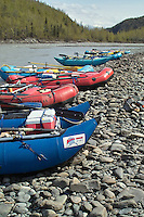 Catamarans and rafts participating in the annual Knik Canoers and Kayakers rafting class are pulled up to shore along the Matanuska River.