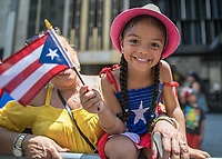 NEW YORK, NY - JUNE 11:  A little girl holds a flag  during  the NYC's 60th annual Puerto Rico Day parade led by mayor Bill de Blasio on June 11, 2017 in New York City. (Photo by Maite H. Mateo/VIEWpress/Corbis via Getty Images)