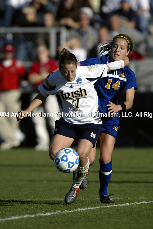 05 December 2004: The referee decided that this foul by Mary Castelanelli (14) on Katie Thorlakson (7) happened inside the penalty area, which lead to Notre Dame's tying goal in the 74th minute. Notre Dame defeated UCLA 4-3 on penalty kicks after the game ended in a 1-1 overtime tie at SAS Stadium in Cary, NC in the championship match in the 2004 NCAA Division I Women's College Cup...