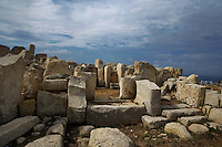 Low angle view of the Main Temple of Hagar Qim, Malta, pictured on June 5, 2008, in the morning. The Republic of Malta consists of seven islands in the Mediterranean Sea of which Malta, Gozo and Comino have been inhabited since c.5,200 BC. It has been ruled by Phoenicians (Malat is Punic for safe haven), Greeks, Romans, Fatimids, Sicilians, Knights of St John, French and the British, from whom it became independent in 1964. Nine of Malta's important historical monuments are UNESCO World Heritage Sites, including  the temple of Hagar Qim which stands on a hilltop in the south of the island of Malta. Typical to Maltese megalithic temple design, it  has a trilithon entrance, outer bench and orthostats. A wide forecourt with a retaining wall and a passage runs through the middle of the building. Although the main temple dates to 3600-3200 BC, the northern ruins are considerably older. The site was excavated during the 19th and 20th centuries. Picture by Manuel Cohen.