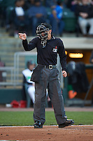 Umpire Tyler Olson makes a call during a game between the Great Lakes Loons and Dayton Dragons on May 21, 2015 at Fifth Third Field in Dayton, Ohio.  Great Lakes defeated Dayton 4-3.  (Mike Janes/Four Seam Images)