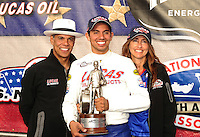 Sept. 5, 2011; Claremont, IN, USA: NHRA pro stock motorcycle rider Hector Arana Jr. celebrates with his family after winning the US Nationals at Lucas Oil Raceway. Mandatory Credit: Mark J. Rebilas-