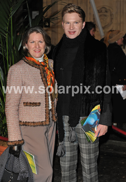 **ALL ROUND PICTURES FROM SOLARPIX.COM**.**WORLDWIDE SYNDICATION RIGHTS**.Outside arrivals at the London premiere of Cirque du Soleil - Varekai.  Held at the Royal Albert Hall, London.  5 January 2009.This pic: Henry Conway and mother..JOB REF: 10429 SSD     DATE: 05_01_2010.**MUST CREDIT SOLARPIX.COM OR DOUBLE FEE WILL BE CHARGED**.**MUST NOTIFY SOLARPIX OF ONLINE USAGE**.**CALL US ON: +34 952 811 768 or LOW RATE FROM UK 0844 617 7637**