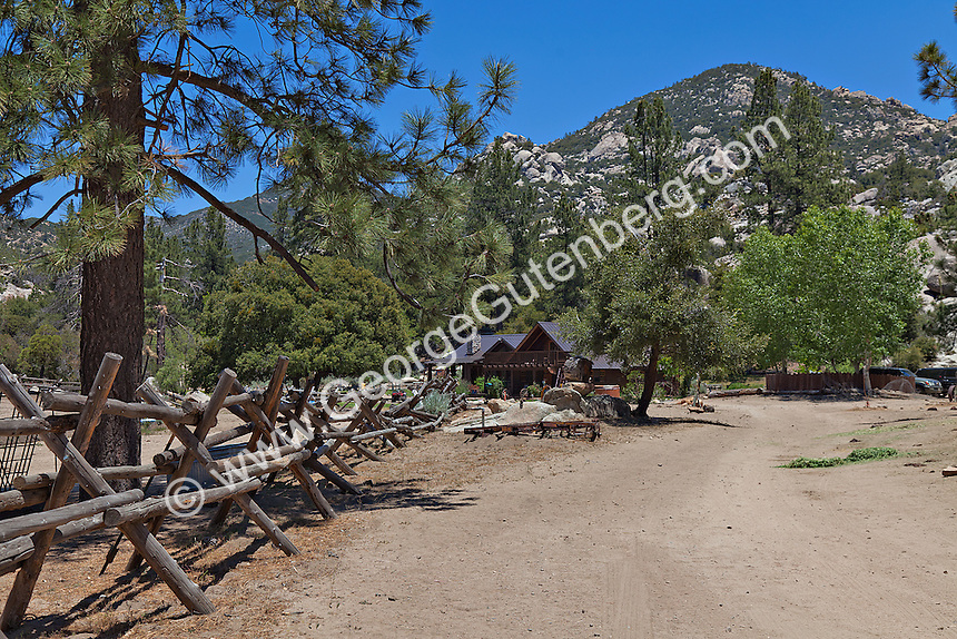 Road leads to Rustic Ranch in mounatins