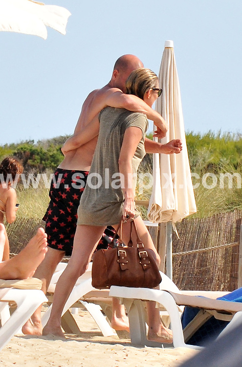 **ALL ROUND EXCLUSIVE PICTURES FROM SOLARPIX.COM**.**WORLDWIDE SYNDICATION RIGHTS EXCLUDING SPAIN - NO PUBLICATION IN SPAIN**.Supermodel Kate Moss had to be helped off the beach yesterday after a 7hr marathon drinking session with friends in Ibiza Spain. .an onlooker said she looked in a great mood laughing and joking and downing jugs of Rose wine followed by liquers..This pic: Kate Moss..JOB REF: 11391         JFM      DATE: 03.06.2010.**MUST CREDIT SOLARPIX.COM OR DOUBLE FEE WILL BE CHARGED**.**MUST AGREE FEE BEFORE ONLINE USAGE**.**CALL US ON: +34 952 811 768 or LOW RATE FROM UK 0844 617 7637**