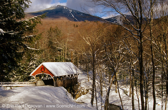 Franconia Notch State Park - Flume Covered Bridge in Lincoln, New Hampshire USA with Mount Liberty in the background