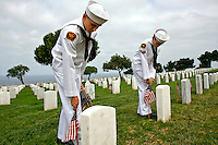 Saturday, May 22, 2009.  Fort Rosecrans National Cemetery, San Diego California, USA:  Cadets George Mick (15) and Daniel Murray (14) of the Miramar based United States Naval Cadet Corps place flags at grave sites in the Fort Rosecrans National Cemetery.  Hundreds of boy scouts, girl scouts and their parents fanned out across the cemetery to plant flags at each grave site to mark Memorial Day..