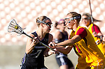 Los Angeles, CA 02/09/13 - Erin Fitzgerald  (Northwestern #7) and Kelsey Dreyer (USC #31) in action during the Northwestern vs USC NCAA Women Lacrosse game at the Los Angeles Colliseum.