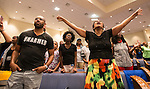 BATON ROUGE, LA -JULY 07:  Cynthia Clark, right, sings during a prayer vigil for Alton Sterling at the Living Faith Christian Center in Baton Rouge, Louisiana July 7, 2016.  Sterling was shot and killed by police on July 5, 2016 in Baton Rouge, Louisiana. (Photo by Mark Wallheiser/Getty Images)