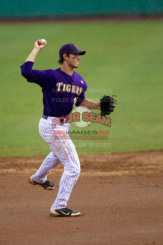 LSU Tigers shortstop Austin Nola #36 throws to first during the NCAA Super Regional baseball game against Stony Brook on June 9, 2012 at Alex Box Stadium in Baton Rouge, Louisiana. Stony Brook defeated LSU 3-1. (Andrew Woolley/Four Seam Images)