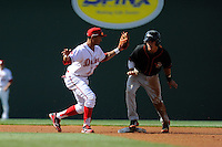Adrian Marin (6) of the Delmarva Shorebirds is out attempting to steal second base, as shortstop Mookie Betts (7) of the Greenville Drive makes the tag in a game on Monday, April 29, 2013, at Fluor Field at the West End in Greenville, South Carolina. Betts was selected by the Boston Red Sox in the 5th Round of the 2011 First-Year Player Draft. Delmarva won, 6-5 in game one of a doubleheader. (Tom Priddy/Four Seam Images)