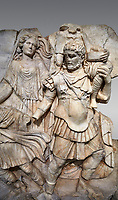 Detail of a Roman Sebasteion relief  sculpture of Aineas&rsquo; flight from Troy, Aphrodisias Museum, Aphrodisias, Turkey.  <br /> <br /> Aineas in armour carries his aged farther Anchises on his shoulders and leads his young son Lulus by his hand. They are fleeing from the sack of Troy. The figure floating behind is Aphrodite, Aineas&rsquo; mother: she is helping their escape. Old Anchises carries a round box that held images of Troy&rsquo;s ancestral gods.