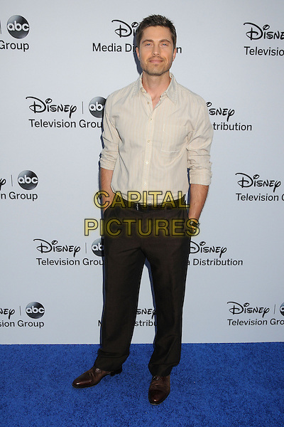 Eric Winter.Disney Media Networks International Upfronts 2013 held at Walt Disney Studios, Burbank, California, USA..May 19th, 2013.full length white shirt brown trousers .CAP/ADM/BP.©Byron Purvis/AdMedia/Capital Pictures