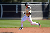 Central Florida Knights infielder Dylan Moore (2) runs the bases during a game against the Siena Saints at Jay Bergman Field on February 16, 2014 in Orlando, Florida.  UCF defeated Siena 9-6.  (Copyright Mike Janes Photography)