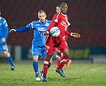 St Johnstone v Aberdeen....02.03.11 .Sone Aluko handles the ball in front of Jody Morris.Picture by Graeme Hart..Copyright Perthshire Picture Agency.Tel: 01738 623350  Mobile: 07990 594431