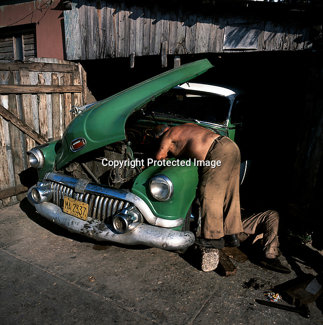 A man repairs an old Buick car on July 8, 1993, in Matanza, Cuba. The country had a severe drop in economic growth since the expiration of aid from the former Soviet Union after the end of communism. Fidel Castro has ruled the communist island for over four decades, and been in war of words with the United States all since then. They country has a good education and medical level but lacks a free press and freedom of speech. (Photo by: Per-Anders Pettersson)