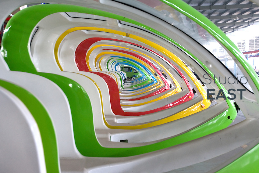 Colorful plastic shapes of what will become electric tricycle cabs in the Nederlands lay in Repow electric vehicles factory, in Jinhua, Zhejiang province, China, on September 17, 2007. Photographer: Lucas Schifres/Pictobank