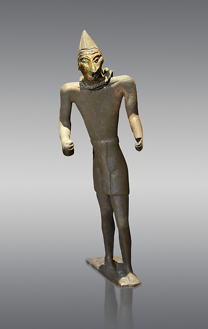 Hittite bronze figure with a mask, Hittite Period. Adana Archaeology Museum, Turkey. Against a grey background