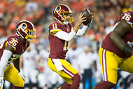 Landover, MD - August 24, 2018: Washington Redskins quarterback Alex Smith (11) takes the snap during preseason game between the Denver Broncos and Washington Redskins at FedEx Field in Landover, MD. The Broncos defeat the Redskins 29-17. (Photo by Phillip Peters/Media Images International)