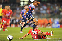 MELBOURNE, AUSTRALIA - JANUARY 23, 2010: Archie Thompson from Melbourne Victory evades a tackle in round 24 of the A-league match between Melbourne Victory and Adelaide United FC at Etihad Stadium on January 23, 2010 in Melbourne, Australia. Photo Sydney Low www.syd-low.com