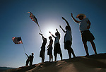 Responding the terrorist attacks on 9.11.2001, college students from CSU-Monterey in Monterey, California climbed to the top of sand dunes overlooking US 101 to wave flags and declare their support and patriotism on the afternoon of the attacks.
