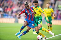Crystal Palace Wilfried Zaha and Norwich City Jamal Lewis during the Premier League match between Crystal Palace and Norwich City at Selhurst Park, London, England on 28 September 2019. Photo by Andrew Aleksiejczuk / PRiME Media Images.