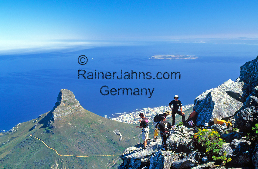 South Africa, Cape Town, roping down from Table Mountain with view at Lion's Head, Sea Point and Robben Island