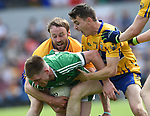 John Hayes  and Martin Mc Mahon of Clare in action against Seamus O Carroll of Limerick during their Munster championship quarter-final game in Cusack park. Photograph by John Kelly.