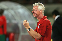 The United States' head coach, Thomas Rongen encourages his team at the start of the game against Cameroon's during the FIFA Under 20 World Cup Group C Match between the United States and Cameroon at the Mubarak Stadium on September 29, 2009 in Suez, Egypt.