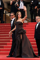 BRAD PITT &amp; ANGELINA JOLIE <br /> 'The Tree of Life' premiere at the Palais des Festival, 64th International Cannes Film Festival, France<br /> 16th May 2011<br /> full length strapless silk satin brown dress gown black tux tuxedo tinted glasses sunglasses shades couple gathered goatee facial hair photographers press holding hands arm in air waving tattoos side slit split <br /> CAP/PL<br /> &copy;Phil Loftus/Capital Pictures /MediaPunch ***NORTH AND SOUTH AMERICAS ONLY***