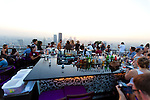 The Banyan Tree Moon Bar on the 61st floor of the Banyan Tree Hotel in downtown Bangkok offers signature cocktails served up with fantastic views of the city of Bangkok, Thailand