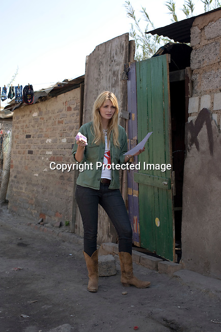 ALEXANDRA, SOUTH AFRICA - SEPTEMBER 2: Mischa Barton, the actress and model, speaks to a camera while visiting Hlayisanani Pre-School on September 2, 2008 in Alexandra, outside Johannesburg, South Africa. Mischa Barton spent 2 days visiting Save The Children supported projects in South Africa, meeting school children and young children. Save The Children are helping about 51,000 children made by HIV/AIDS and poverty to access food, healthcare, social security and education. (Photo by Per-Anders Pettersson/Getty Images For Save The Children).