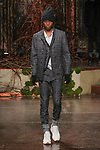 Model walks runway in an outfit from the John Varvatos 2.0 Fall Winter 2018 collection at The Angel Orensanz Foundation in New York City, on January 26, 2018.
