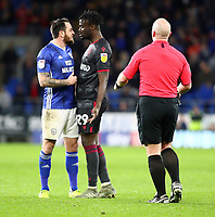 31st January 2020; Cardiff City Stadium, Cardiff, Glamorgan, Wales; English Championship Football, Cardiff City versus Reading; Lee Tomlin of Cardiff City confronts Pele of Reading during a stoppage in play