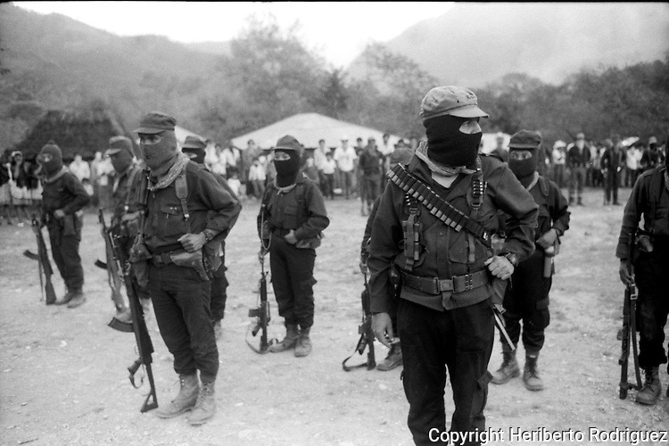 Zapatista rebel Subcomandante Marcos reviews his troops in the Zapatista stronghold La Garrucha village in the Lacandonian jungle in southern state of Chiapas, March 22, 1994.  Photo by Heriberto Rodriguez