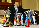 Alex McLeish in June 2003 with the Treble in the Ibrox blue room