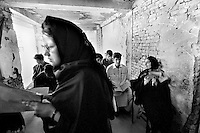 For the first time since before the rule of the Taliban, girls and boys are allowed to study together in an improvised classroom in Kabul, Afghanistan on July 6, 2002.