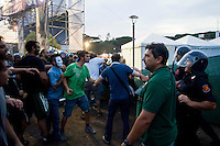 Roma 11 Luglio 2013<br /> Manifestazione di precari contro le politiche di austerit&agrave;, per il reddito, casa e diritti.<br /> Tensioni e scontri tra la polizia e i manifestanti, davanti all'ingresso della Festa del Partito Democratico al parco  Shuster, Quartiere Ostiense<br /> Manifestation of temporary workers against austerity policies, for income, housing and rights.<br /> Tensions and clashes between police and protesters in front of the entrance of the Feast of the Democratic Party in the park Shuster, District Ostiense