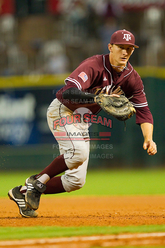 Jacob House #27 of the Texas A&M Aggies breaks towards the first base line for a ground ball against the Rice Owls at Minute Maid Park on March 5, 2011 in Houston, Texas.  Photo by Brian Westerholt / Four Seam Images