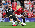 Manchester United's Antonio Valencia tussles with West Ham's Marko Arnautovic during the premier league match at Old Trafford Stadium, Manchester. Picture date 13th August 2017. Picture credit should read: David Klein/Sportimage