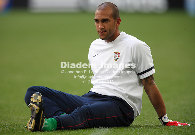 GELSENKIRCHEN, GERMANY - JUNE 12:  United States goalkeeper Tim Howard stretches during warm ups prior to a FIFA World Cup soccer match against the Czech Republic June 12, 2006 in Gelsenkirchen, Germany.  (Photograph by Jonathan P. Larsen)