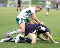 Sonia Bompastor #8 of the Washington Freedom is pinned down by Lori Chalupny #17 of St. Louis Athletica during a WPS match at the Maryland Soccerplex on May 3, 2009 in Boyds Maryland. The game ended in a 3-3 tie.