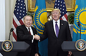 United States President Donald J. Trump shakes hands with President Nursultan Nazarbayev of Kazakhstan during a  joint press statements in the  Roosevelt Room of the White House January 16, 2018 in Washington, DC. <br /> Credit: Olivier Douliery / Pool via CNP